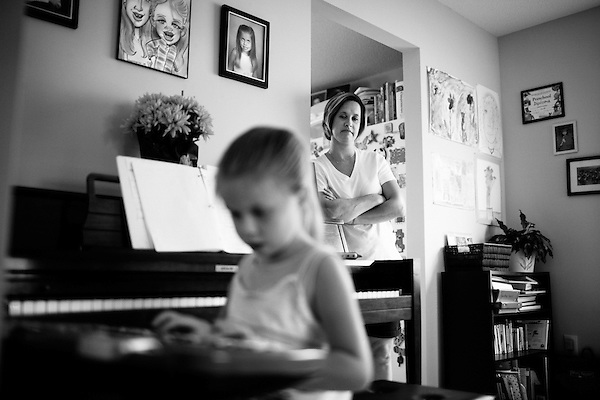 June 4, 2009. Raleigh, NC.. Due to the economic downturn, the state of North Carolina has proposed the closing of the Governor Morehead School, a school for the visually impaired in Raleigh. If no solution is found the school could be moved out of Raleigh, or merged with  the state's schools for blind and deaf children.  . Paige Strickland, a severely visually impaired child, graduated from the Gov. Morehead School, and her mother Jennifer says the school offers services for VI children that no other school in the area can.. Paige plays the piano, one of the many instruments she is learning to play.