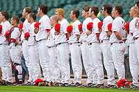 The Houston Cougars during the National Anthem prior to their game against the Baylor Bears at Minute Maid Park on March 4, 2011 in Houston, Texas.  Photo by Brian Westerholt / Four Seam Images