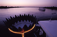 The Nile after sunset, seen from the roof terrace of the Oberoi Philae. Fake chimney with light chain.