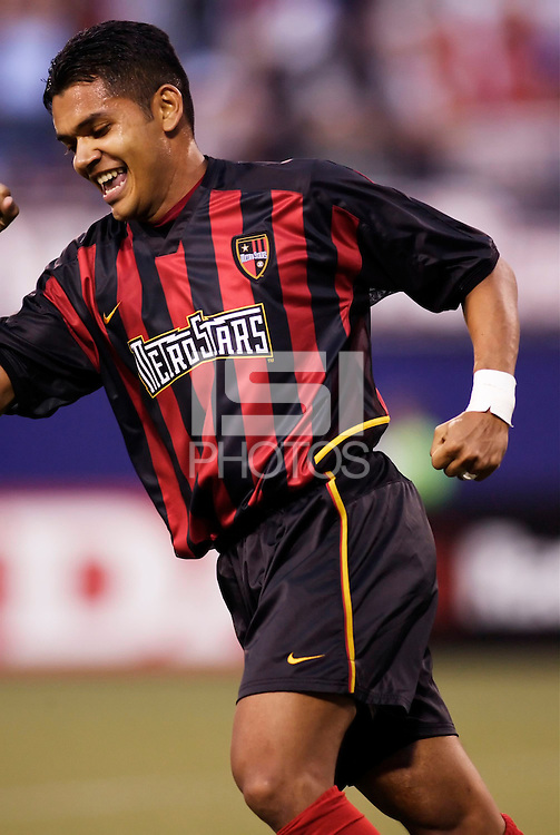 The MetroStars' Amado Guevara celebrates his assist on Fabian Taylor's goal in the 13th minute to open the scoring. The Chicago Fire played the NY/NJ MetroStars to a one all tie at Giant's Stadium, East Rutherford, NJ, on May 15, 2004.