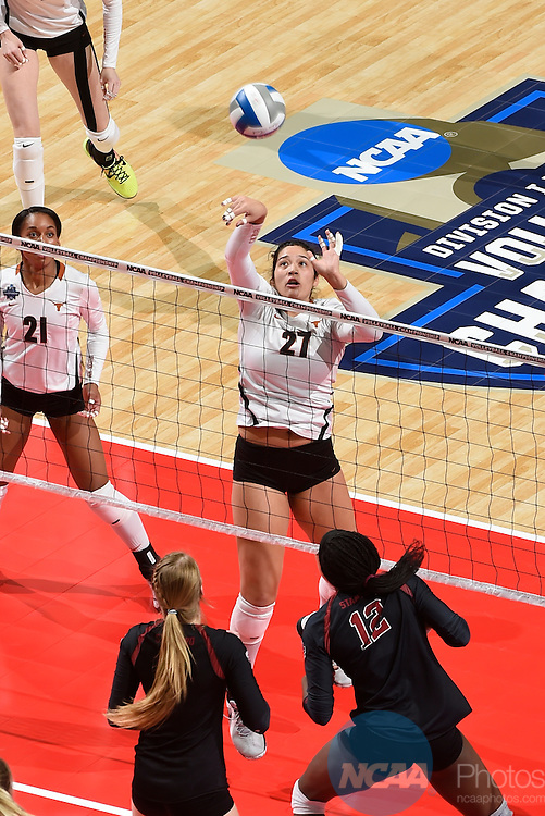 COLUMBUS, OH - DECEMBER 17:  Yaazie Bedart-Ghani (27) of the University of Texas dinks the ball against Stanford University during the Division I Women's Volleyball Championship held at Nationwide Arena on December 17, 2016 in Columbus, Ohio.  Stanford defeated Texas 3-1 to win the national title. (Photo by Jamie Schwaberow/NCAA Photos via Getty Images)