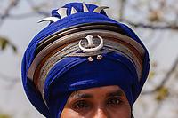 Asia,India,Punjab, Anandpur Sahib,  Portrait of an  Akali Nihang ( Sikh warrior-priest ), to the Holla Mohalla annual festival