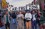 Camden Hight street is shut down by Reclaim the Streets (RTS).  `RTS  was born of the road protests at Twyford Down and the M11 , a response to the prevailing  car culture and associated pollution and  alienation.