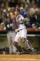 Catcher Kevin Gonzalez #10 of the Texas A&M Aggies makes a throw to first base versus the Rice Owls in the 2009 Houston College Classic at Minute Maid Park February 28, 2009 in Houston, TX.  The Owls defeated the Aggies 2-0. (Photo by Brian Westerholt / Four Seam Images)