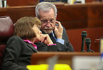 Nevada Assembly Republicans Robin Titus and Glenn Trowbridge work on the Assembly floor at the Legislative Building in Carson City, Nev., on Wednesday, April 1, 2015. <br /> Photo by Cathleen Allison