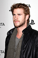 LOS ANGELES - FEB 15:  Liam Hemsworth at the Sony PlayStationAE Unveils PS VITA Portable Entertainment System at the Siren Studios on February 15, 2012 in Los Angeles, CA