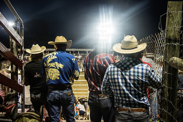 Cowboys watch a rodeo event, Cowtown, New Jersey, USA