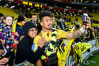 Ardie Savea poses with a fan after the Super Rugby Final between The Hurricanes and The Lions at Westpac Stadium, Wellington, New Zealand on Saturday, 6 August 2016. Photo: Marco Keller / lintottphoto.co.nz