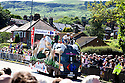 Grand Depart - Tour de France 2014<br /> Yorkshire England.<br /> Leaders go through famous town of Ilkley with Moors in distance.<br /> <br /> Float rider in king of the mountains top<br /> <br /> <br /> Pic by Gavin Rodgers/Pixel 8000 Ltd