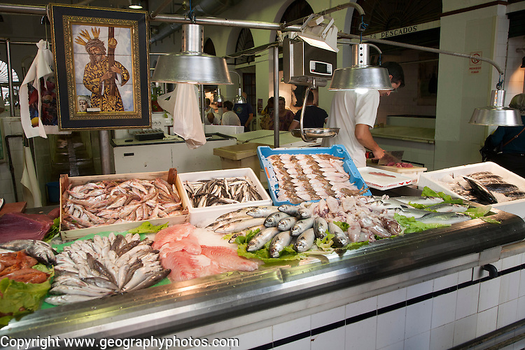 Fish stall in Barrio Macerana market, Seville, Spain