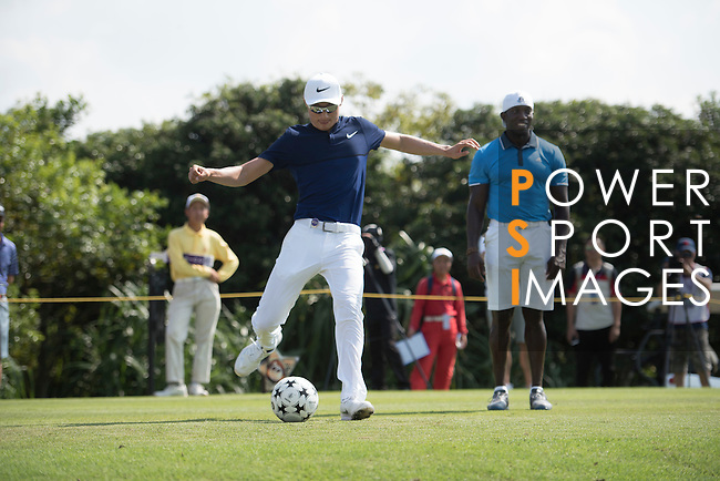 Li Haotong kicks a football at the 14th hole during the World Celebrity Pro-Am 2016 Mission Hills China Golf Tournament on 22 October 2016, in Haikou, China. Photo by Weixiang Lim / Power Sport Images