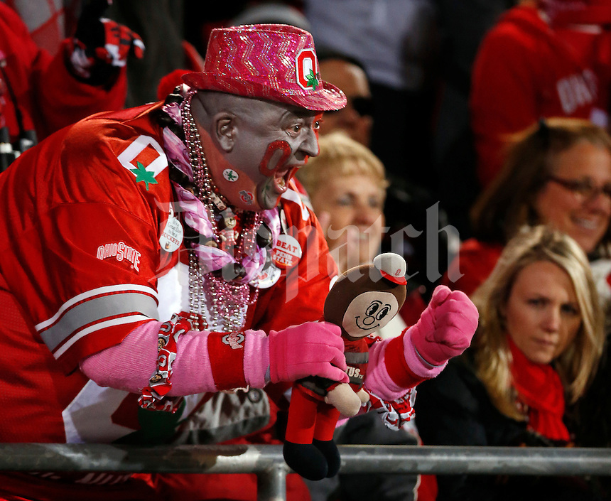 "Donned in pink for breast cancer awareness, Ohio State football super fan Jon ""Big Nut"" Peters cheers on the Buckeyes during the second half of the NCAA football game at Ohio Stadium in Columbus on Oct. 26, 2013. (Adam Cairns / The Columbus Dispatch)"