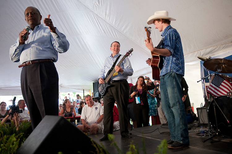 UNITED STATES - AUGUST 13:  Republican presidential candidate Herman Cain, left, and former Arkansas governor Mike Huckabee perform a gospel song for supporters in Cain's tent at the Ames Straw Poll at the Iowa State University in Ames, Iowa.  (Photo By Tom Williams/Roll Call)