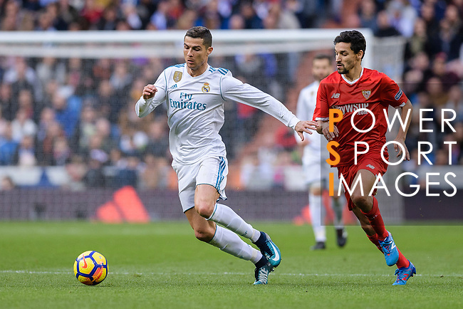 Cristiano Ronaldo of Real Madrid (L) fights for the ball with Jesus Navas of Sevilla FC (R) during La Liga 2017-18 match between Real Madrid and Sevilla FC at Santiago Bernabeu Stadium on 09 December 2017 in Madrid, Spain. Photo by Diego Souto / Power Sport Images