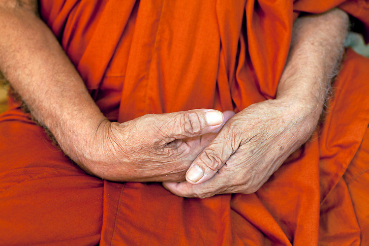 Details of the hands of a 80-year-old blind monk lives in a temple in a village near Battambang, Cambodia. <br /> <br /> Photos &copy; Dennis Drenner 2013.