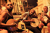 BRAZIL, Rio de Janiero, individuals gather and play music in Morro da Conceição, Lapa