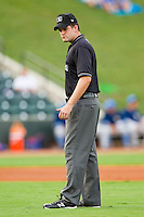 Umpire John Bacon handles the calls on the bases during the Carolina League game between the Myrtle Beach Pelicans and the Winston-Salem Dash at BB&T Ballpark on July 5, 2012 in Winston-Salem, North Carolina.  The Dash defeated the Pelicans 12-5.  (Brian Westerholt/Four Seam Images)