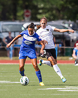 In a National Women's Soccer League Elite (NWSL) match, Portland Thorns FC defeated the Boston Breakers, 2-1, at Dilboy Stadium on July 21, 2013.  Boston Breakers forward Lianne Sanderson (10) holds the ball from Portland Thorns FC forward Alex Morgan (13).