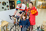Trish Hergarty and Leilani Boland encouraging Tommy Sheehy with an orange on Saturday morning in Manor West Shopping Centre, as Tommy is doing a spinathon to achieve the €100,000 mark in fundraising for Enable Ireland Kerry and he is €1,600 of of the target.