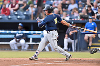 Columbia Fireflies first baseman Eudor Garcia (5) swings at a pitch during a game against the Asheville Tourists at McCormick Field on August 17, 2016 in Asheville, North Carolina. The Tourists defeated the Fireflies 7-6. (Tony Farlow/Four Seam Images)
