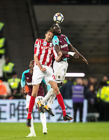 Cheikhou Kouyate of West Ham United & Peter Crouch of Stoke City during the Premier League match between West Ham United and Stoke City at the Olympic Park, London, England on 16 April 2018. Photo by Andy Rowland.