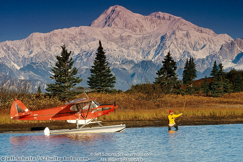 Man Views Mt Mckinley & Alaska Range From Floatplane