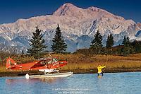 Man Views Mt Mckinley & Alaska Range From Floatplane