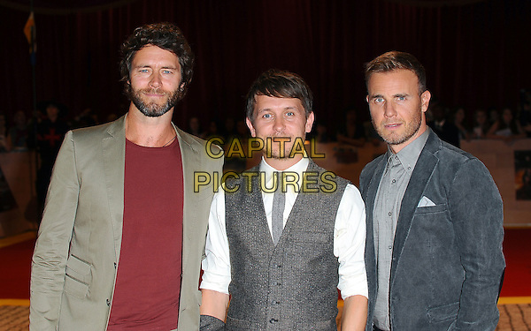 Howard Donald, Mark Owen & Gary Barlow of Take That.'The Three Musketeers in 3D' world film premiere, Vue cinema, Westfield, London, England. 4th October 2011.half length beige trousers red maroon top grey gray waistcoat white shirt blue suit jacket band group beard facial hair .CAP/BEL.©Tom Belcher/Capital Pictures.