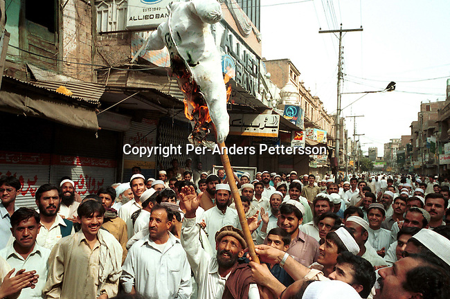 Demonstrators burning a doll of US President George Bush at a pro-Taleban demonstration on September 21, 2001 in the old town in Peshawar, Pakistan. During a national strike people demonstrated all over the country in support of Osama Bin Laden and the Taleban movement in Afghanistan..Photo: Per-Anders Pettersson/ iAfrika Photos..