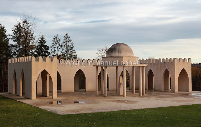 Memorial to muslim soldiers, inaugurated by French President Jacques Chirac in 2006 on the 90th anniversary of the Battle of Verdun, in memory of the 28,000 muslim soldiers who died at Verdun in World War One, at the Ossuaire de Douaumont or Douaumont Ossuary, at Douaumont, Verdun, Meuse, Lorraine, France. The monument is built in Moorish style, with a 25m long ambulatory with crenellated roofline and a central koubba or cupola. Picture by Manuel Cohen