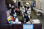 Sandra Antoine, a volunteer with Organizing for America, President Obama's re-election campaign arm, works the front desk in the group's Richmond headquarters on Thursday, May 3, 2012 in Richmond, VA.