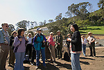 Ranger-led tour of Angel Island State Park, San Francisco Bay, CA, California, the Immigration Station where 175,000 Chinese were processed 1910-1940, with the Barracks now being restored, and poignant poetry of the detainees on the walls preserved.  Sometimes called the Ellis Island of the West..Photo camari233-70507..Photo copyright Lee Foster, www.fostertravel.com, 510-549-2202, lee@fostertravel.com.