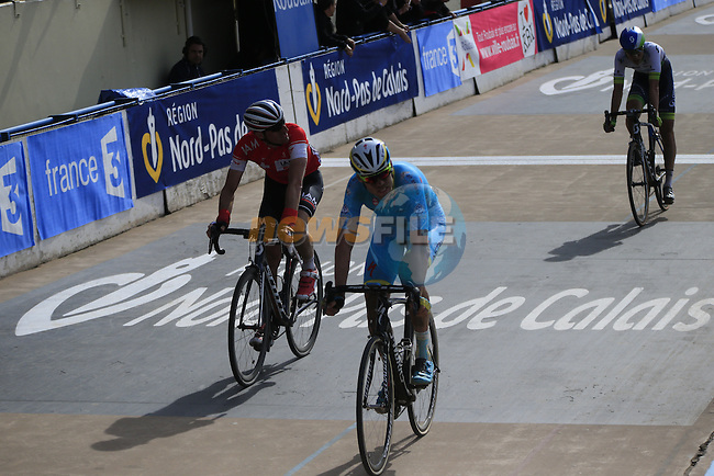 Lars Boom (NED) Astana, Martin Elmiger (SUI) IAM Cycling and Jens Keukeleire (BEL) Orica GreenEdge cross the line 4th 5th and 6th in the famous Roubaix Velodrome at the end of the 113th edition of the Paris-Roubaix 2015 cycle race held over the cobbled roads of Northern France. 12th April 2015.<br /> Photo: Eoin Clarke www.newsfile.ie