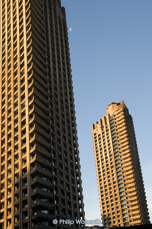 Two of the three towers of the Barbican Estate in the City of London.  The 42 storey towers are London's tallest residential buildings.