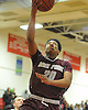 Darien Jenkins #20 of Deer Park drives to the net during a Suffolk County varsity boys basketball game against host Half Hollow Hills West High School on Thursday, Jan. 19, 2017. Deer Park won by a score of 59-49.