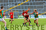 Mark Crowley Mid Kenmare attacks Fiachra Clifford Mid Kerry during their SFC quarter final in Fitzgerald Stadium on Sunday