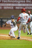 Mickey Gasper (33) of the Pulaski Yankees stretches for a throw as Nate Scantlin (17) of the Greeneville Reds hustles towards first base at Calfee Park on June 23, 2018 in Pulaski, Virginia. The Reds defeated the Yankees 6-5.  (Brian Westerholt/Four Seam Images)