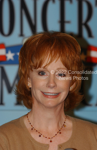 "Reba McEntire, country singer, speaks at a press availability as he rehearsed for the ""Concert for America"" at the John F. Kennedy Center for the Performing Arts in Washington, DC on 9 September, 2002..Credit: Ron Sachs / CNP"