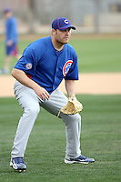 Thomas Diamond #20 of the Chicago Cubs participates in pitchers fielding practice during spring training workouts at the Cubs complex on February 19, 2011  in Mesa, Arizona. .Photo by Bill Mitchell / Four Seam Images.