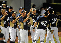 Florida International University team congratulates left handed pitcher Mason McVay (27) during the game against Florida Atlantic University. FAU won the game 5-1 on March 16, 2012 at Miami, Florida.