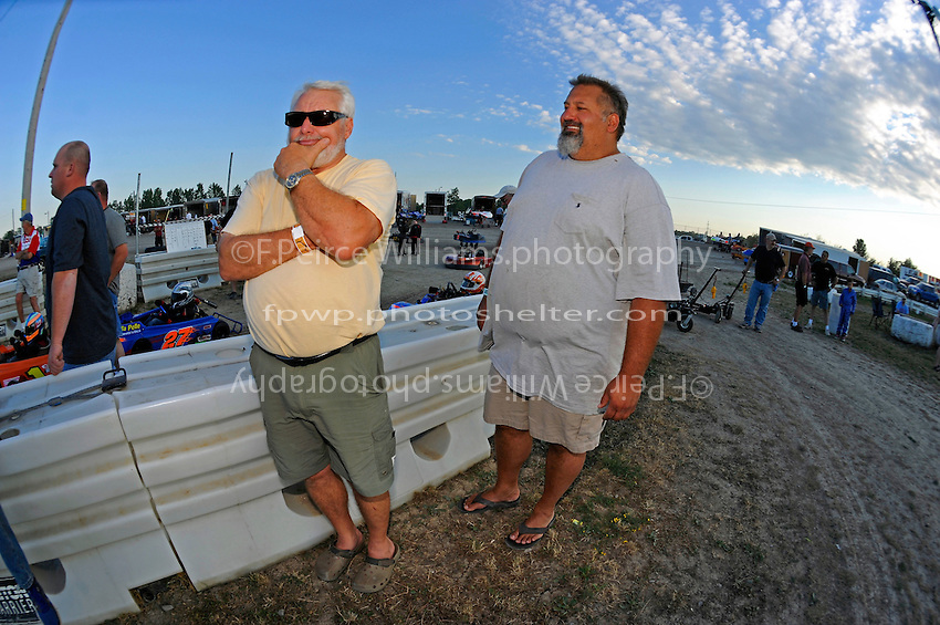 Bill Hesson and son-in-law David Mazur watch the races.