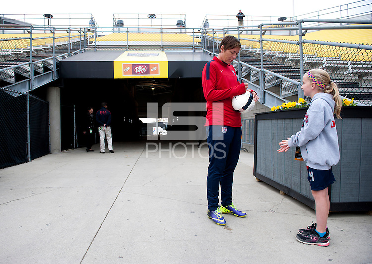 USWNT forward Abby Wambach signs an autograph before practice at Crew Stadium in Columbus, OH.