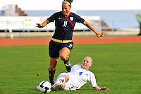 Lauren Cheney eludes a tackle from Rakel Honnudottir of Iceland.  The USWNT defeated Iceland (2-0) at Vila Real Sto. Antonio in their opener of the 2010 Algarve Cup on February 24, 2010.