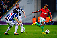 Saturday, 9 March 2013<br /> <br /> Pictured: Claudio Yacob of West Bromwich Albion Chris Brunt of West Bromwich Albion and Wayne Routledge of Swansea City<br /> <br /> Re: Barclays Premier League West Bromich Albion v Swansea City FC  at the Hawthorns, Birmingham, West Midlands