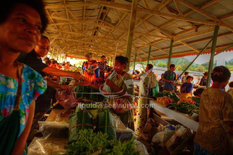 """A colorful market with lots of fruits, vegetables and fish, and of course everyone's favorite here-betelnut at Alotau. Alotau is the capital of Milne Bay Province, a province of Papua New Guinea..The town is located within the area in which the invading Japanese army suffered their first land defeat in the Pacific War in 1942, before the Kokoda Track battle. A memorial park at the old battle site commemorates the event..Alotau became the provincial capital in 1969 after it was shifted from Samarai..Alotau is the gateway to the Milne Bay Province which contains some of the most remote island communities in the world. Renowned for its friendly people and amazing tropical islands, it is a very well kept secret and sees very few tourists each year. The whole of Milne bay offers some of the worlds best scuba diving and coral reef experiences..Alotau itself is a busy regional """"Outpost""""-like town. Most facilities are available here although it can be sporadic at times.."""