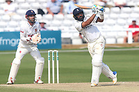 Jeetan Patel hits six runs for Warwickshire as James Foster looks on from behind the stumps during Essex CCC vs Warwickshire CCC, Specsavers County Championship Division 1 Cricket at The Cloudfm County Ground on 21st June 2017