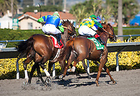 August 26, 2012. Dullahan and Joel Rosario(right) turn for home on their way to winning the Pacific Classic(GI) at Del Mar Thoroughbred Club in Del Mar, CA..