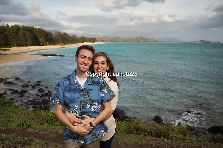 Ellefsen Christmas card photo shoot ant Kailua boat ramp on windy day.