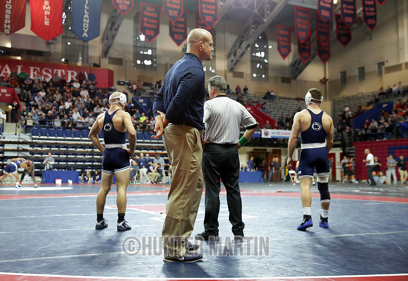 PHILADELPHIA, PA - NOVEMBER 18: Brady Berge (R) and Jarod Verkleeren (L) of the Penn State Nittany Lions wait during a video review as head coach Cael Sanderson looks on during the 149 pound semi-final match at the Keystone Classic on November 18, 2018 at The Palestra on the campus of the University of Pennsylvania in Philadelphia, Pennsylvania. (Photo by Hunter Martin/Getty Images) *** Local Caption *** Brady Berge;Jarod Verkleeren;Cael Sanderson