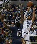 Nevada forward Caleb Martin (10) takes a shot over Akron center Deng Riak (10) in the first half of an NCAA college basketball game in Reno, Nev., Saturday, Dec. 22, 2018. (AP Photo/Tom R. Smedes)